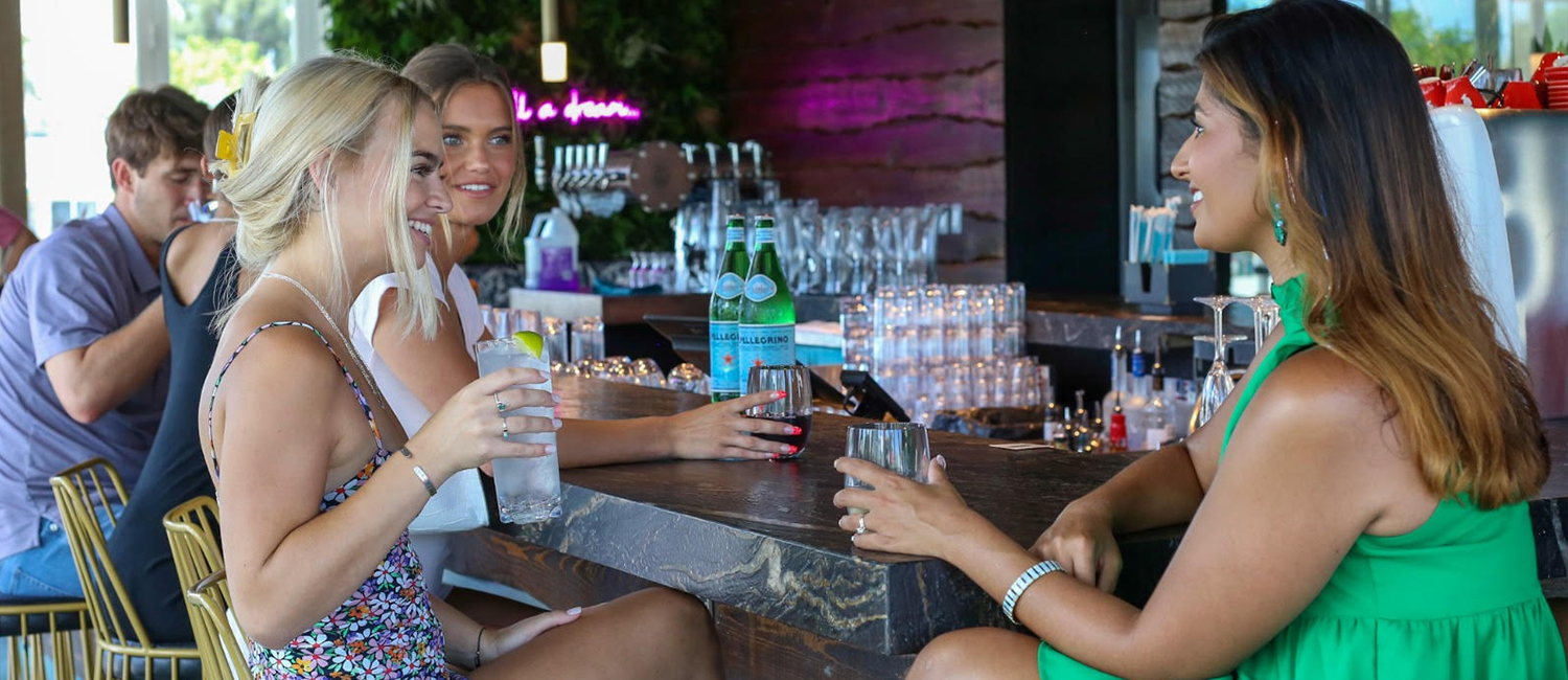 CRAFT COCKTAILS AND THE COOL GULF BREEZE ARE WAITING FOR YOU AT 82 DEGREES